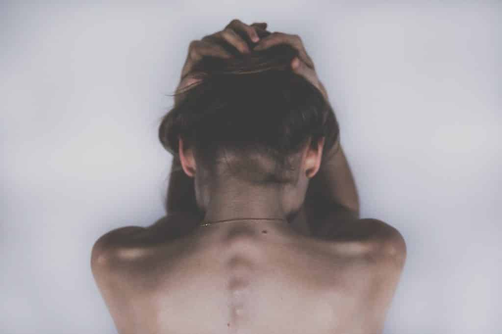 Person in pain with visible back